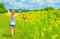 Walking on sunflower field Royalty Free Stock Photo