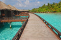 Walking together towards the future getaway island holiday on overwater bungalow with platform heading Royalty Free Stock Image