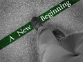 Walking towards a new beginning man across green line with words Stock Image