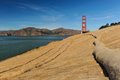 Walking trail next to ocean with erosion control mesh burlap covers ground path Stock Photos