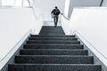 Walking upstairs indoors Royalty Free Stock Photo
