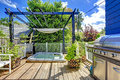 Walkout deck with jacuzzi and pergola. Royalty Free Stock Photo
