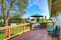 Walkout deck with patio table set and umbrella. Royalty Free Stock Photo