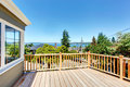 Walkout deck with railings wooden overlooking driveway and neighborhood Stock Photos
