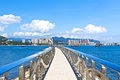 Walkway along the coast with Hong Kong skyline Royalty Free Stock Photography
