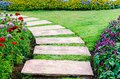 Walkway in the flowers garden Royalty Free Stock Images