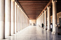 Walkway in a greek museum with columns next to the acropolis athens greece Stock Photo