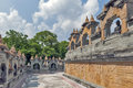 Walkway inside a huge complex of Chedi Hin Sai, sandstone stupas resembling Borobudur at Wat Pa Kung Temple, Roi Et, Thailand Royalty Free Stock Photo