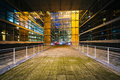 Walkway and modern building at night, at La Défense, in Paris, Royalty Free Stock Photo