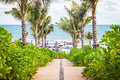 Walkway to the beach in a beautiful park with palms rayong thailand Royalty Free Stock Photos