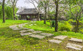 The walkway to a vintage Chinese pavilion in the garden Royalty Free Stock Photo