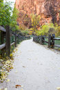 Walkway in zion np relaxing national park with autumn colors and sandstone cliffs Stock Photo