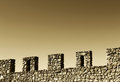 Wall with battlements space for text sepia hue a composition an ancient stone from the medieval castle of mussomeli sicily a well Stock Photo