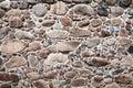 Wall of big stones and broken bricks Royalty Free Stock Photo