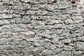 Wall of big stones and broken bricks