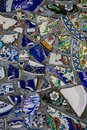 Wall with broken ceramic plates colored Royalty Free Stock Photo
