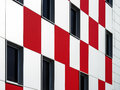 Wall of building with pattern windows and panels Royalty Free Stock Photo