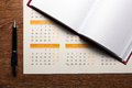 Wall calendar with pen and diary closeup Royalty Free Stock Photo