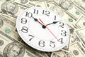 Wall clock and dollars Royalty Free Stock Photo