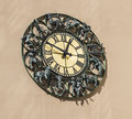 Wall clock with figurines zodiac signs Royalty Free Stock Photo