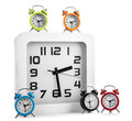 Wall clock and several alarm clock white Stock Images