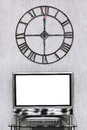 Wall clock under blank white screen of tv set mitnight time on Royalty Free Stock Photos