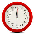 Wall clock on white background twelve o clock Stock Photo