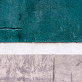 Wall closeup of a turquoise grey and white facade of a house Royalty Free Stock Photography