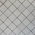 Wall covered with tile - diagonal square texture Royalty Free Stock Photos