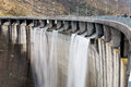 Wall of the dam with overflow Royalty Free Stock Photo