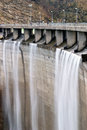 Wall of the dam with overflow Stock Photography