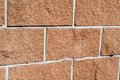 Wall deatil of from yellow ragstone bricks Stock Photos