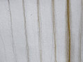 Wall with dirty streaks old cracked textured light colored Stock Photos