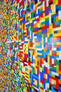 A wall full of lego pieces side vertical view colorful Royalty Free Stock Image