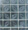 Wall from glass transparent square blocks closeup Stock Images