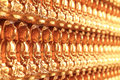 Wall of golden buddha a thousand in a temple with shallow depth pf field Stock Image