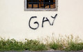 Wall with graffiti brick the word gay written spray Royalty Free Stock Photos