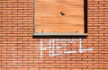 Wall with graffiti brick the word hell written spray Royalty Free Stock Image