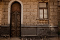 The wall of the house with old doors Royalty Free Stock Image