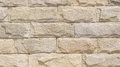 Wall lined with limestone slabs in sunny day Stock Images
