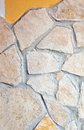 Wall lined with porphyry stones light yellow Royalty Free Stock Photo
