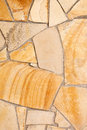 Wall lined with porphyry stones light yellow Royalty Free Stock Photos