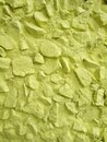 The wall is made of rubble painted in light yellow Royalty Free Stock Photo