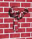 Wall man cartoon figure coming out of a brick Stock Photos