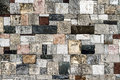 Wall of many stones old is composed different colors shapes and sizes Stock Photos