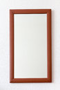 Wall mirror in wooden brown frame Royalty Free Stock Photo