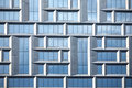 Wall of modern office building of glass and metal in techno style as background Royalty Free Stock Photography