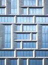 Wall of modern office building of glass and metal in techno style as background vertical view Royalty Free Stock Photo