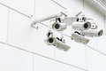 Wall mounted surveillance camera on the Stock Images