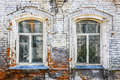 Wall of old brick house with windows arch Stock Images